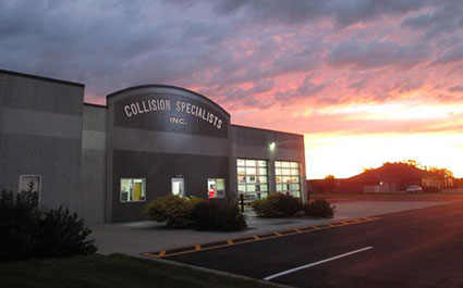 collision specialists building at dawn